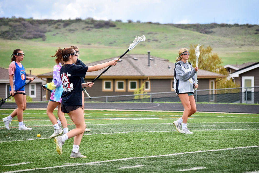 Photo of Rock Canyon High School girls lacrosse team playing.