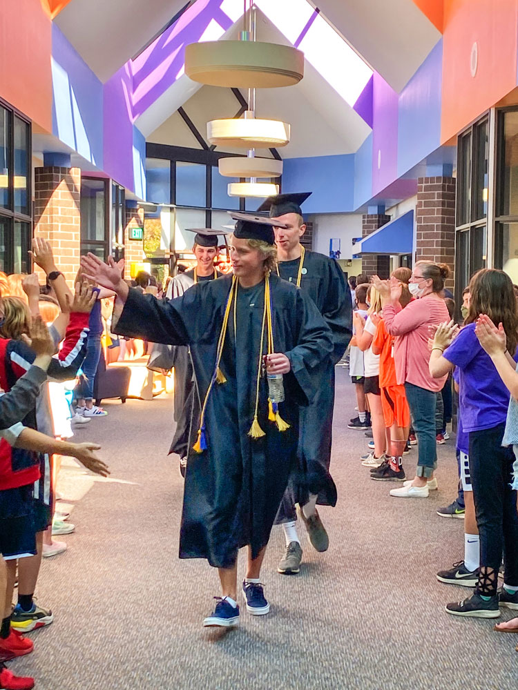 Photo of former Buffalo Ridge students give high-fives upon return to BRE.