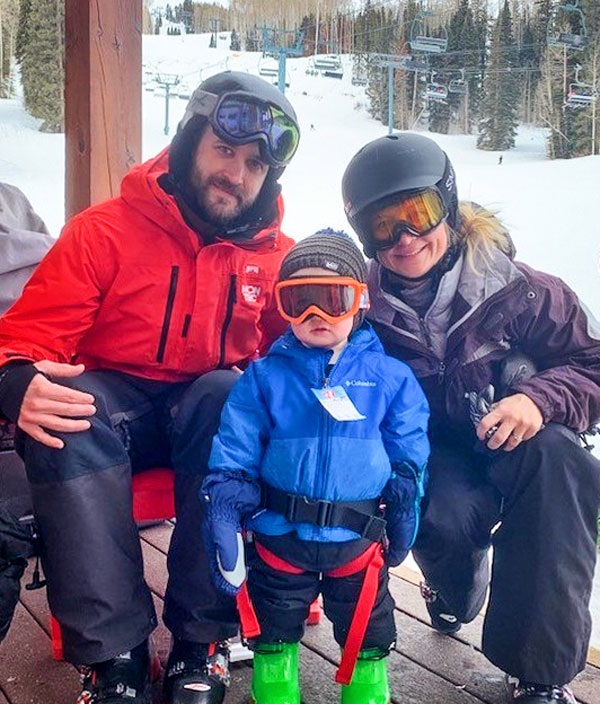 Photo of the Coufal family on a ski outing.