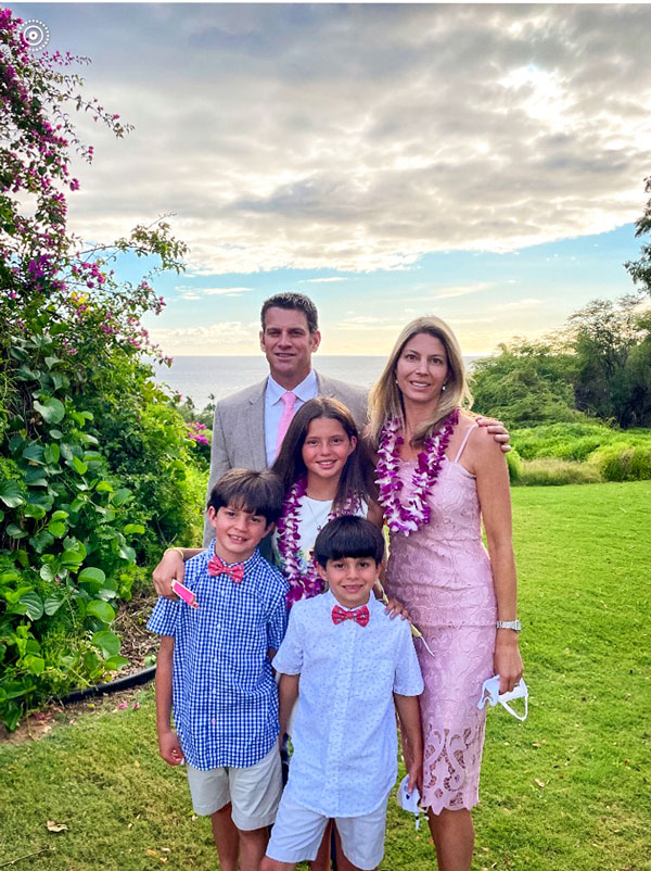 Photo of Drs. Michael and Laura Rosenberg at a wedding in Maui, Hawaii with their children Reese (11), Noah (9) and Cameron (7).