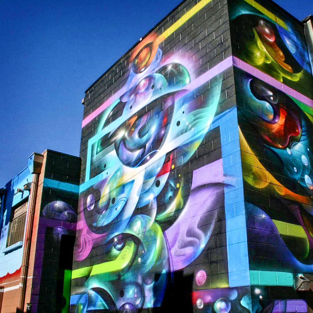 """Photo of """"Reverberations"""" mural in River North Art District, Denver."""