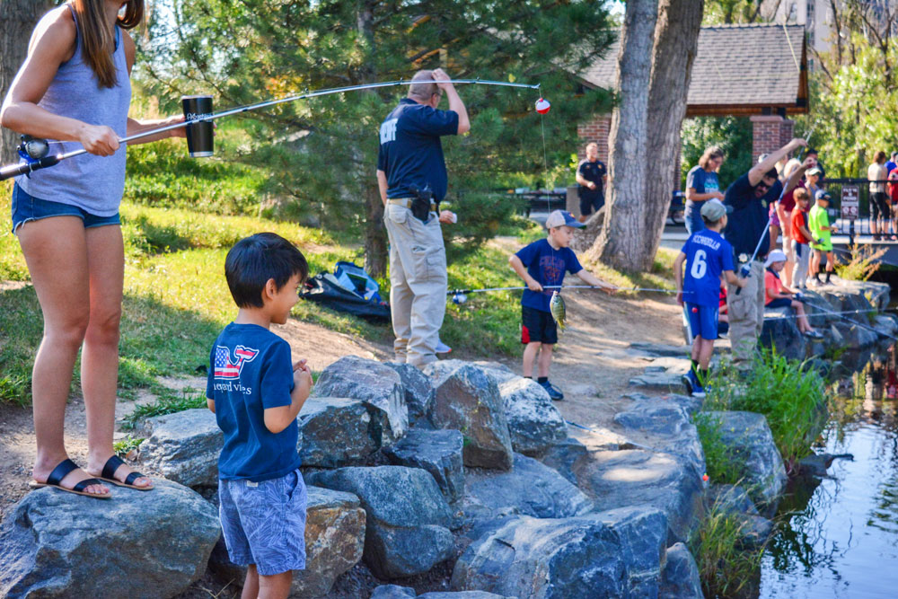 Photo of Kids join forces with Douglas County Sheriff's Office (DCSO) deputies for a fun morning of fishing