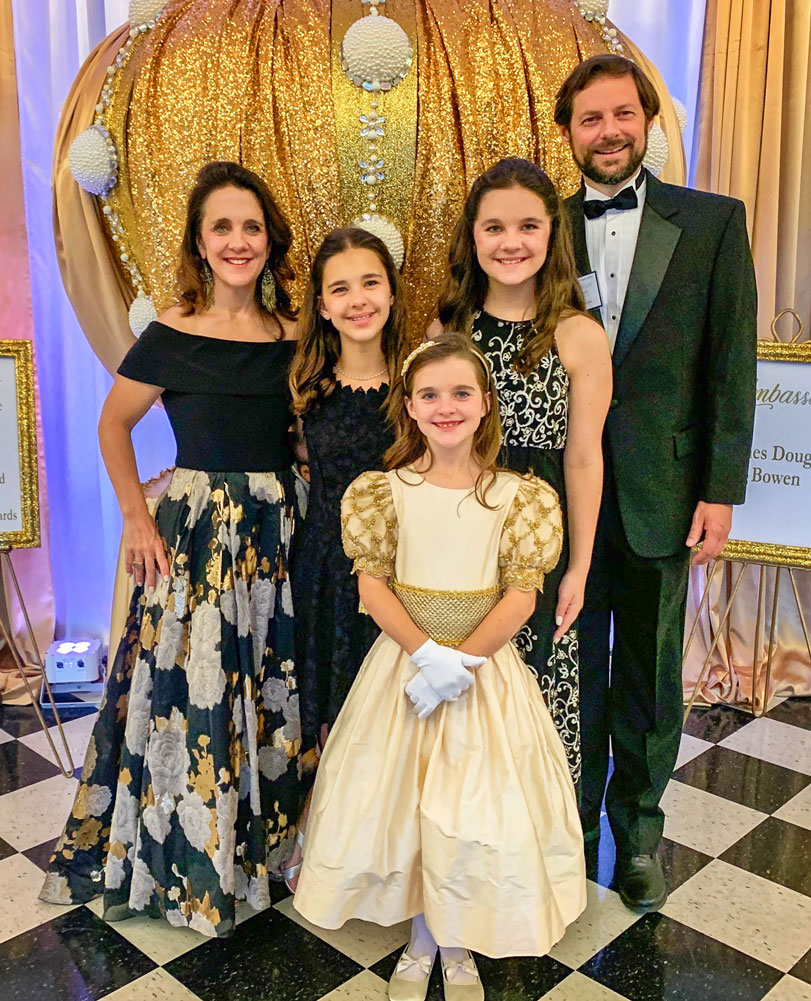 Photo of J.D. Ressetar, now a father of three, is pictured above with his wife and daughters