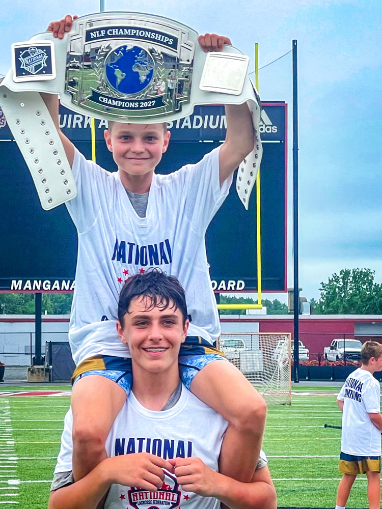 Photo of Jack Whitehouse sits atop Noah Pacheco's shoulders.