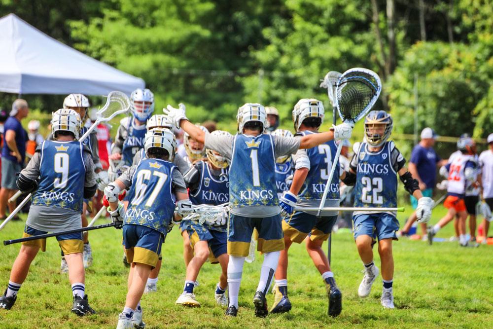Photo of King Lacrosse team celebrating.