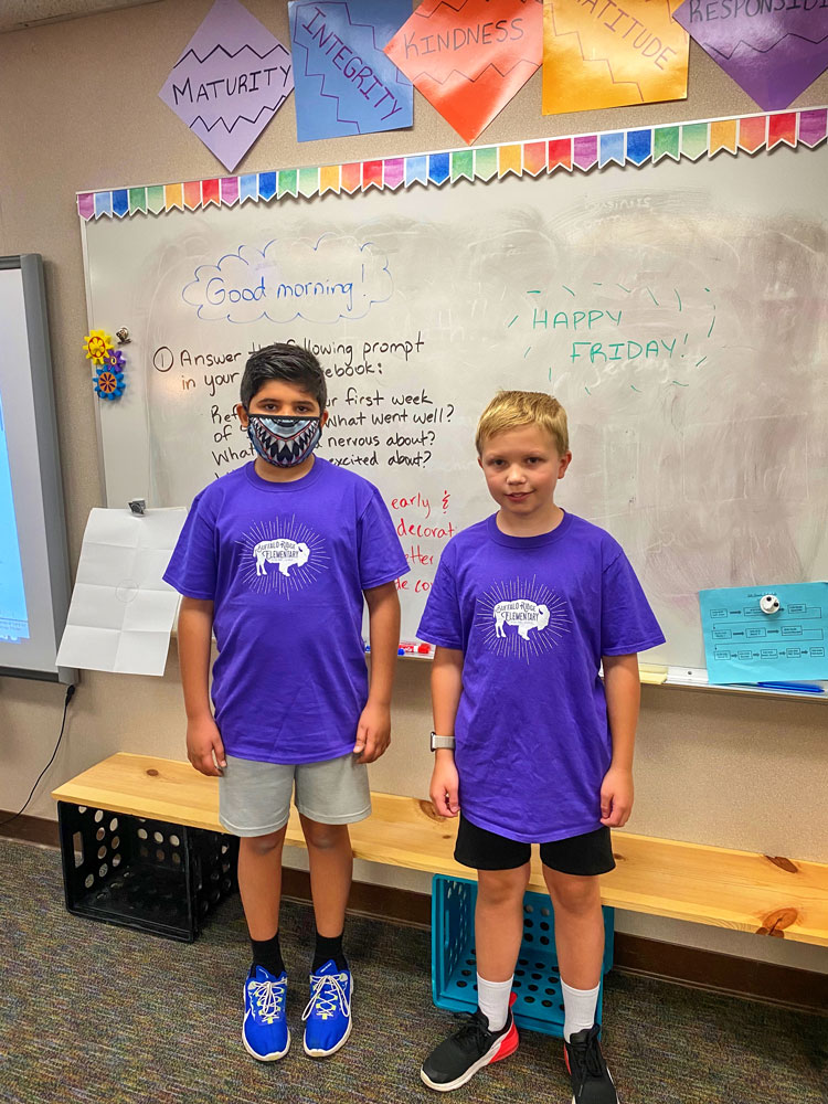Photo of Thomas D. and Caleb M. standing in BRE classroom.