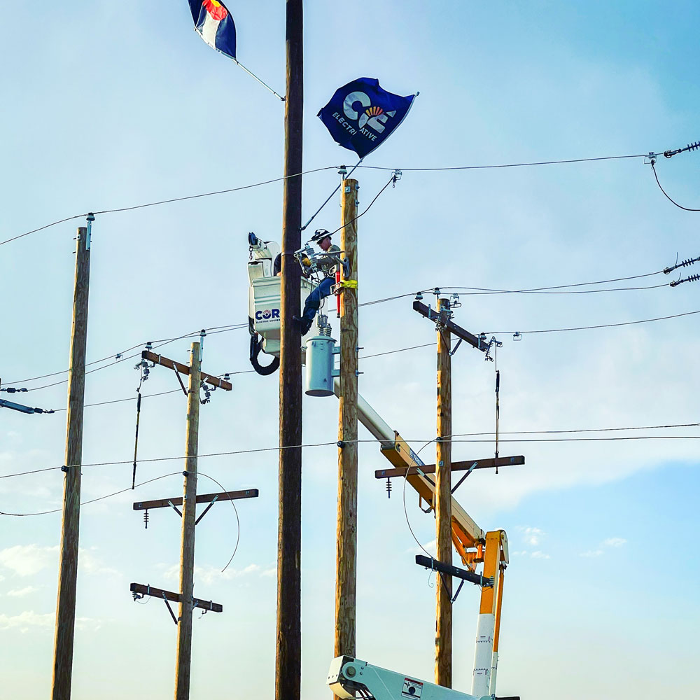Photo of Jeff Baudier, 45 feet in the air atop a utility pole.