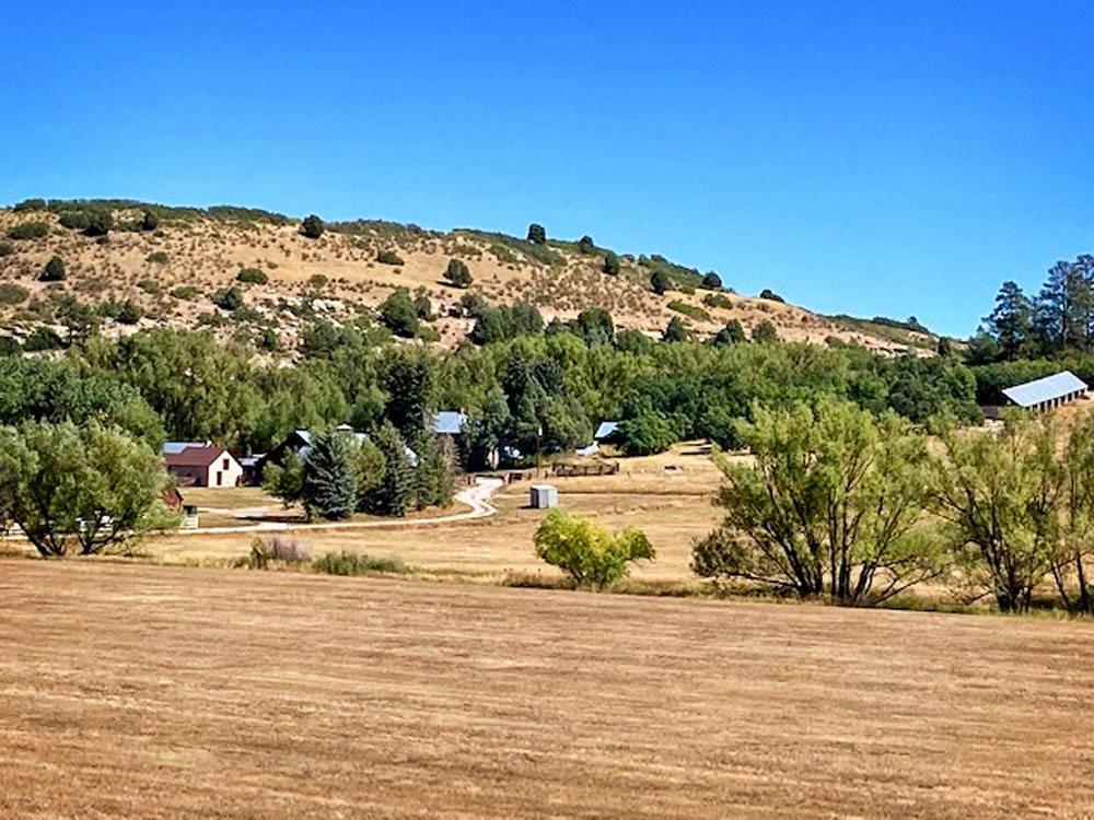 Photo of The GE Ranch complex including original homestead and outbuilding
