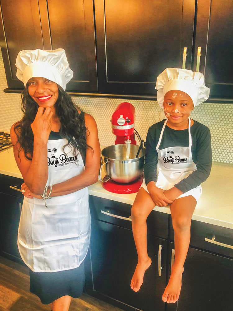 Photo of Yvonne Bailey and her sous-chef and son, Chase.