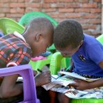 Photo of eager students who want to learn, students devour the books and supplies.