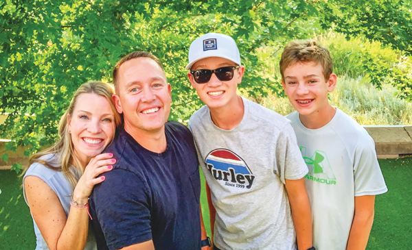 Photo of Tony Greene, his wife Erika (left), and sons Gavin and Gage.