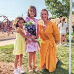 Photo of fourth grader Elise Avetisy, her sister Margot (left) and TTE music teacher Madison Armstrong.